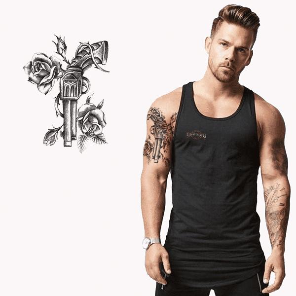 Ajutine-vesi-tattoo-revolver-ja-roosid-49900